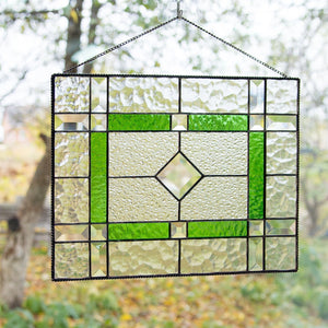 Stained glass clear panel with green and beveled inserts