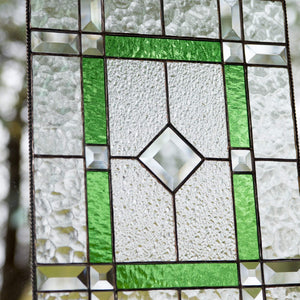 Zoomed stained glass panel with green and beveled inserts for window decoration