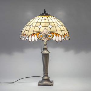 Lit stained glass classic Tiffany lamp with beige inserts