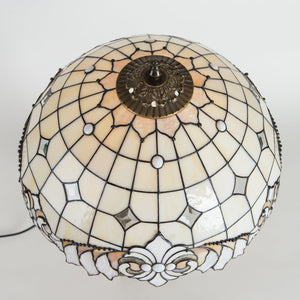 Top view of stained glass Tiffany classic lamp in beige colours