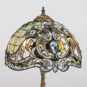 Zoomed stained glass green Tiffany lampshade with blue beveled inserts and variety of markings