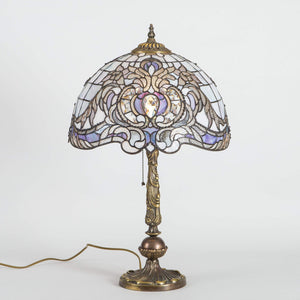 Stained glass Tiffany lamp with beveled inserts and light purple markings