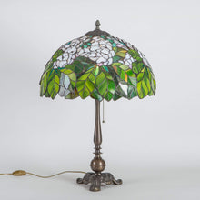 Load image into Gallery viewer, Stained glass Tiffany lamp with green leaves and white flowers