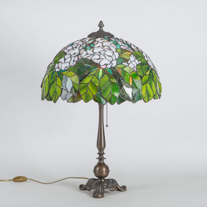 Stained glass Tiffany lamp with green leaves and white flowers