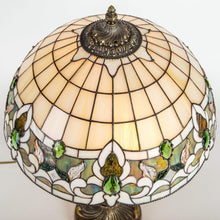 Load image into Gallery viewer, Top view of stained glass Tiffany lamp in beige and green colours