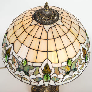 Top view of stained glass Tiffany lamp in beige and green colours
