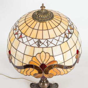 Top view of stained glass beige Tiffany lampshade with red inserted markings