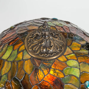 The engraving on top of stained glass dragonfly lamp