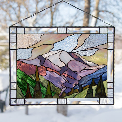 Stained glass window hanging of Mount Rainier National park with its adjacent forest