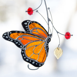 Zoomed lower side view monarch butterfly suncatcher