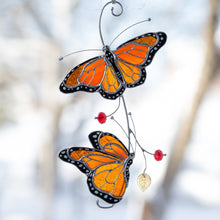Load image into Gallery viewer, Suncatcher of stained glass monarch butterflies on the branch