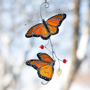 Bright monarch butterflies of stained glass suncatcher