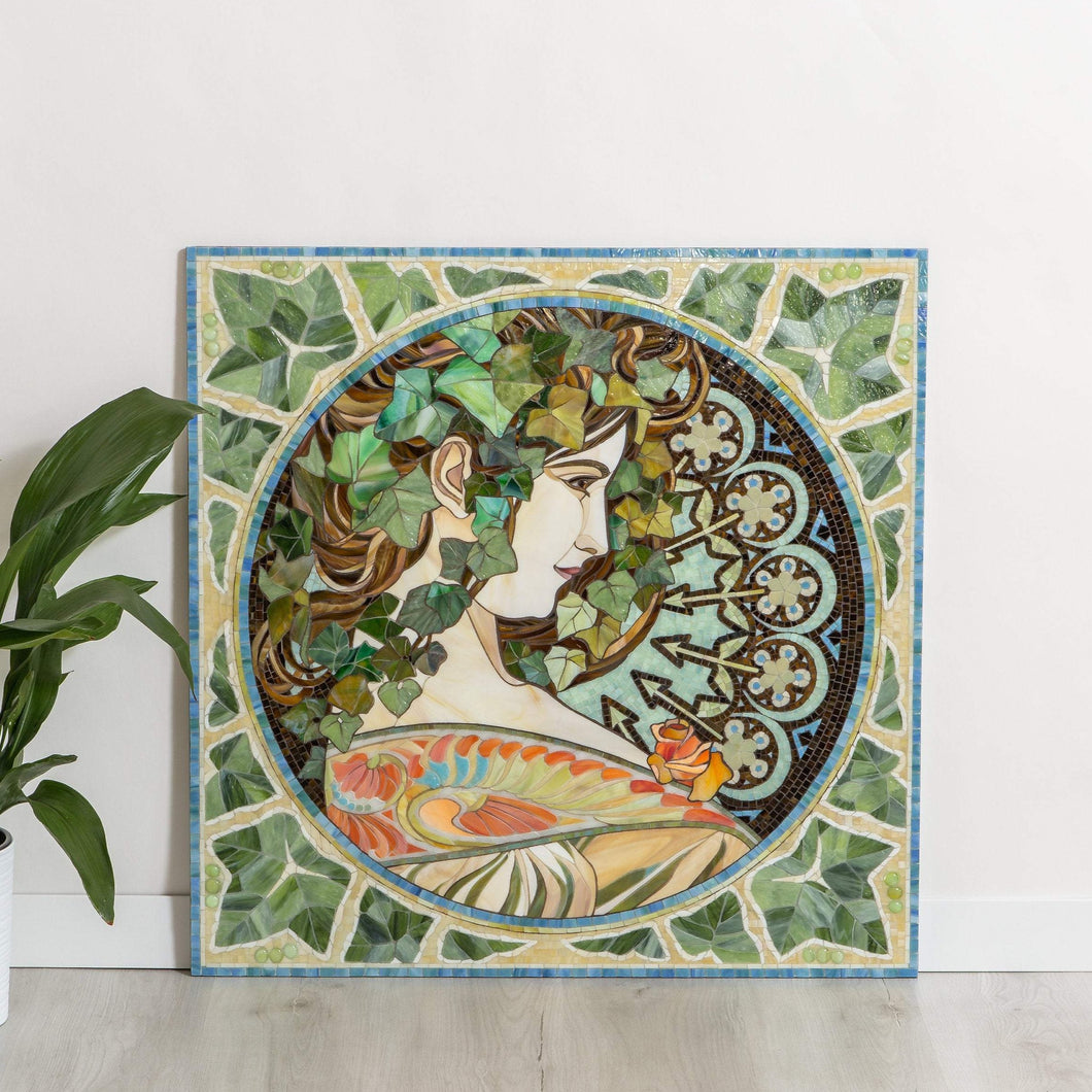 Mosaic of stained glass depicting woman in ivy leaves based on Alphons Mucha's pattern