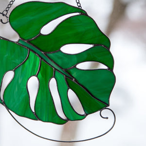 Zoomed stained glass monstera leaf suncatcher