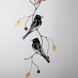 Stained glass phoebe birds sitting on the branch window hanging