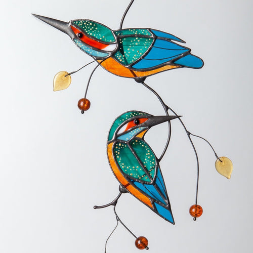 Two bright kingfishers on the wire branch made of stained glass  Edit alt text