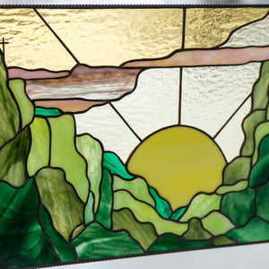 Zoomed stained glass sunset window hanging