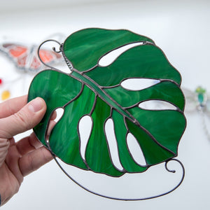 Suncatcher of a stained glass monstera leaf for home decor