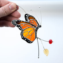 Load image into Gallery viewer, Side view monarch butterfly stained glass window hanging