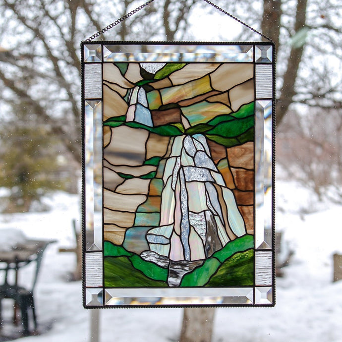 Stained glass panel depicting Bridal Veil Falls in Utah with its cliffs