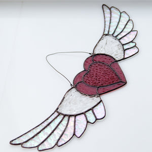 Suncatcher of a stained glass iridescent-winged heart