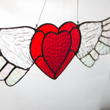 Load image into Gallery viewer, Zoomed stained glass iridescent-winged heart suncatcher for window