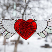 Load image into Gallery viewer, Zoomed stained glass heart with iridescent wings window hanging