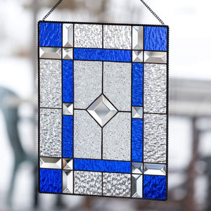 Cobalt and clear stained glass panel with beveled inserts