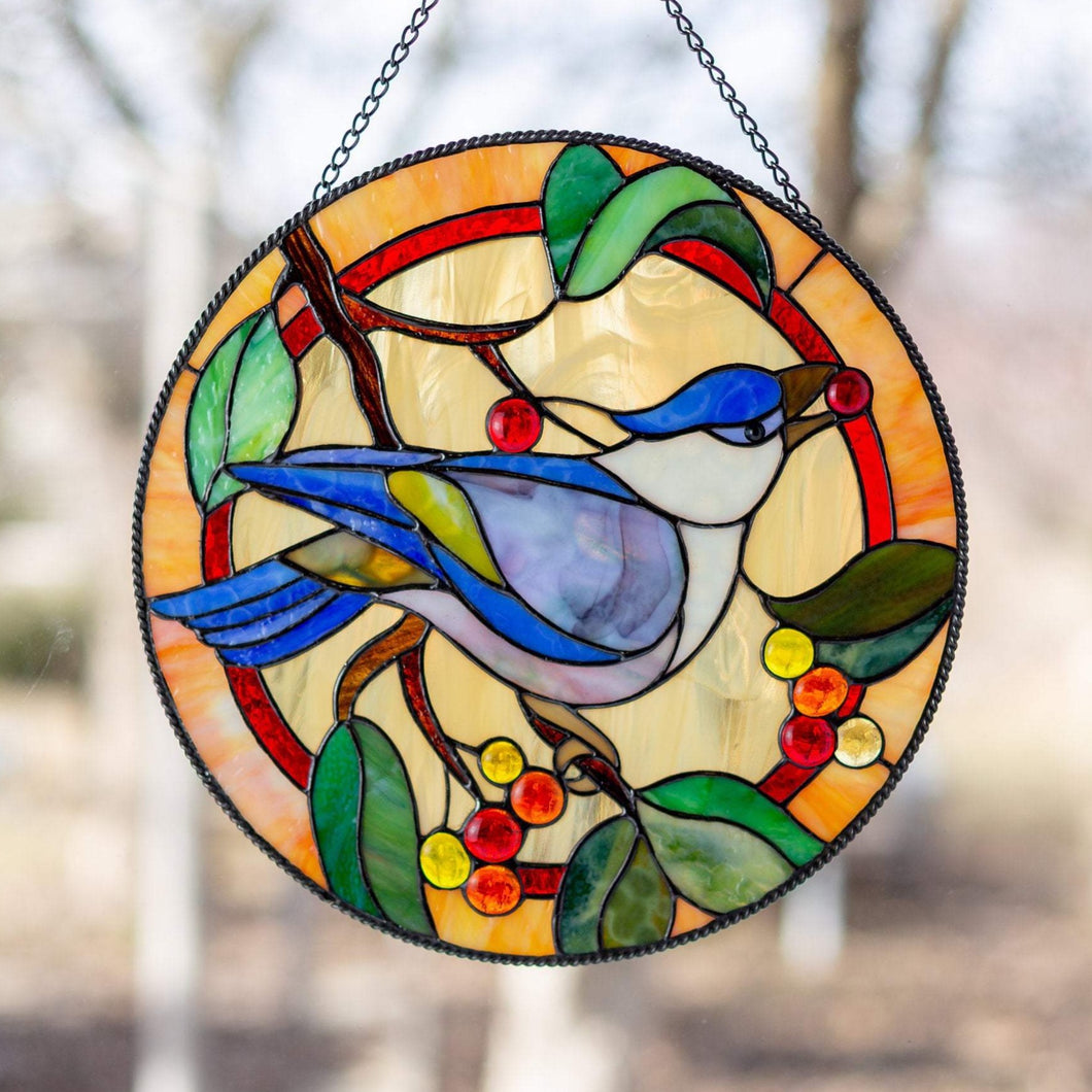 Blue jay with berry in its pecker stained glass round panel for window