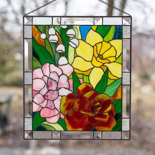 Stained glass panel depicting Marigold, Daffodil, Carnation and Lily for window decoration
