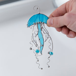 Stained glass blue jellyfish with clear tentacles window hanging