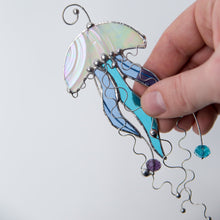 Load image into Gallery viewer, Window hanging of a stained glass white jellyfish with blue tentacles