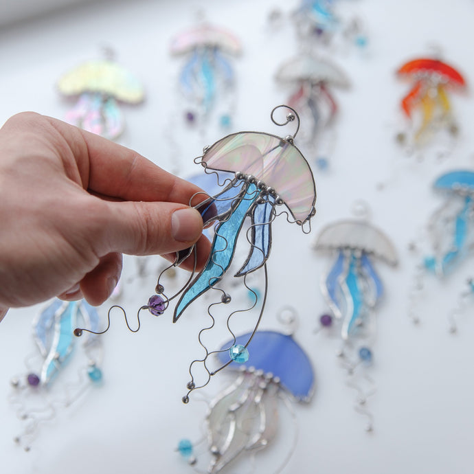 Jellyfish with blue tentacles stained glass window hanging