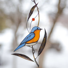 Load image into Gallery viewer, Bluebird with bass leaves stained glass window hanging