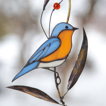 Load image into Gallery viewer, Stained glass suncatcher of a bluebird on the branch with brass leaves