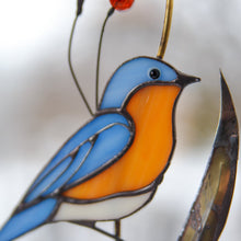 Load image into Gallery viewer, Zoomed stained glass bluebird with bass leaves window hanging