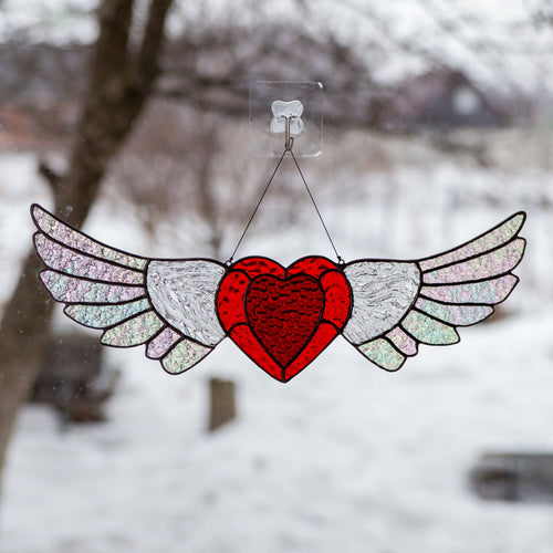 Stained glass heart with iridescent wings suncatcher