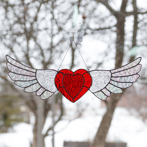 iridescent-winged stained glass heart window hanging
