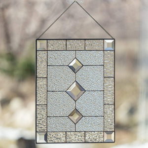 Clear stained glass window panel with beveled inserts