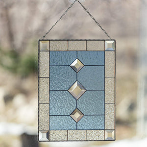 Stained glass beveled panel of blue colour with clear borders