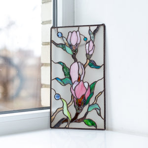 Magnolia flowers on white stained glass background panel