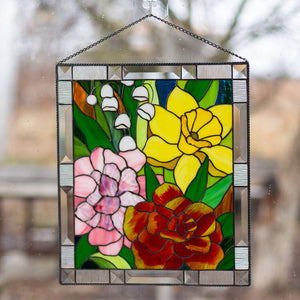 Marigold, daffodil, carnation and lily panel of stained glass