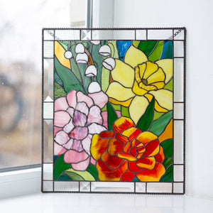 Stained glass panel depicting marigold, daffodil, carnations and lily window hanging