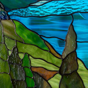 Zoomed stained glass panel of cape Breton highlands national park