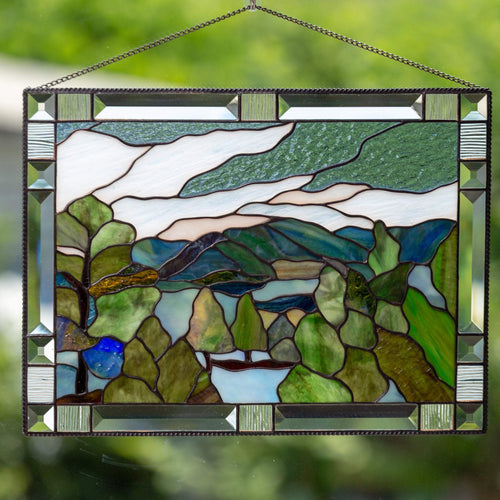 Stained glass panel depicting Estes Park with its flora and mountains