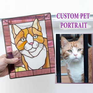 Red cat portrait in a pink frame panel of stained glass