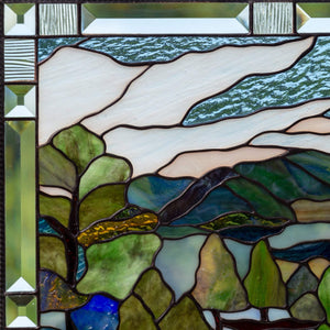Zoomed stained glass panel depicting Estes Park