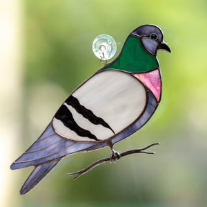 Colourful stained glass pigeon on the branch suncatcher