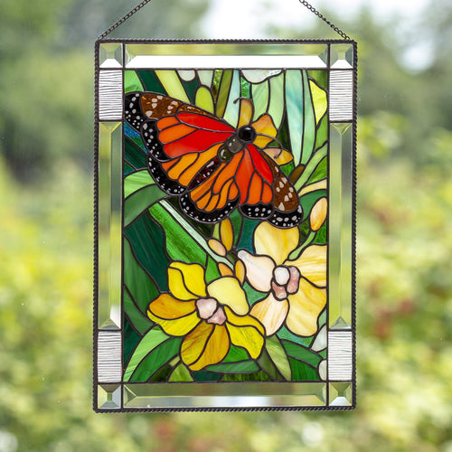 Stained glass panel depicting monarch butterfly with yellow orchids