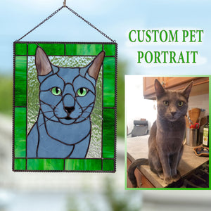 Rectangular stained glass portrait of a cat in a green frame